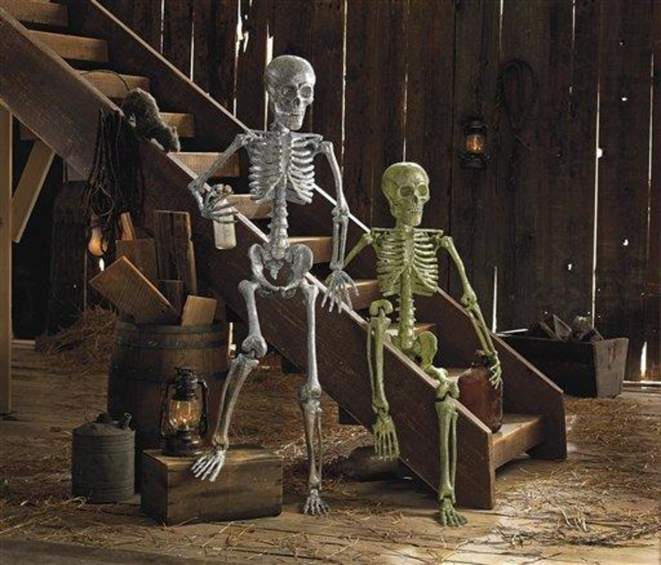 Photo - This product image released by Grandin Road shows their life-size glittery skeletons. This season you'll find lots of ghoulish yet glamorous pieces to decorate with for Halloween.    (AP Photo/Grandin Road)