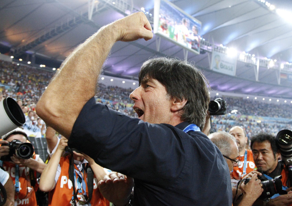 Photo - Germany's head coach Joachim Loew acknowledges the cheers during a victory lap after the World Cup final soccer match between Germany and Argentina at the Maracana Stadium in Rio de Janeiro, Brazil, Sunday, July 13, 2014. Germany won the match 1-0. (AP Photo/Matthias Schrader)