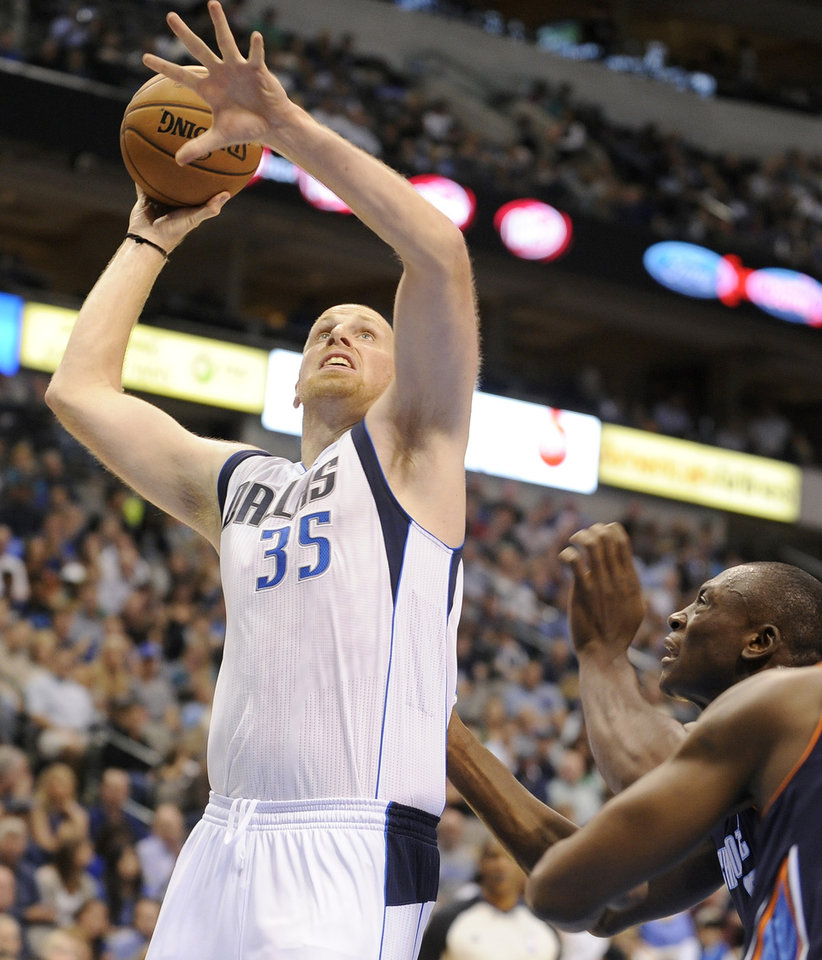 Dallas Mavericks center Chris Kaman (35) goes up for a shot in the second half during an NBA basketball game against the Charlotte Bobcats, Saturday, Nov. 3, 2012, in Dallas. (AP Photo/Matt Strasen)