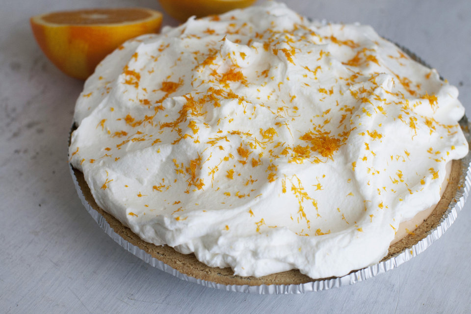 Photo - This July 21, 2014 photo shows orange-vanilla ice cream pie with orange whipped cream in Concord, N.H. The dish offers the creamy-sweet richness of a Creamsicle. (AP Photo/Matthew Mead)