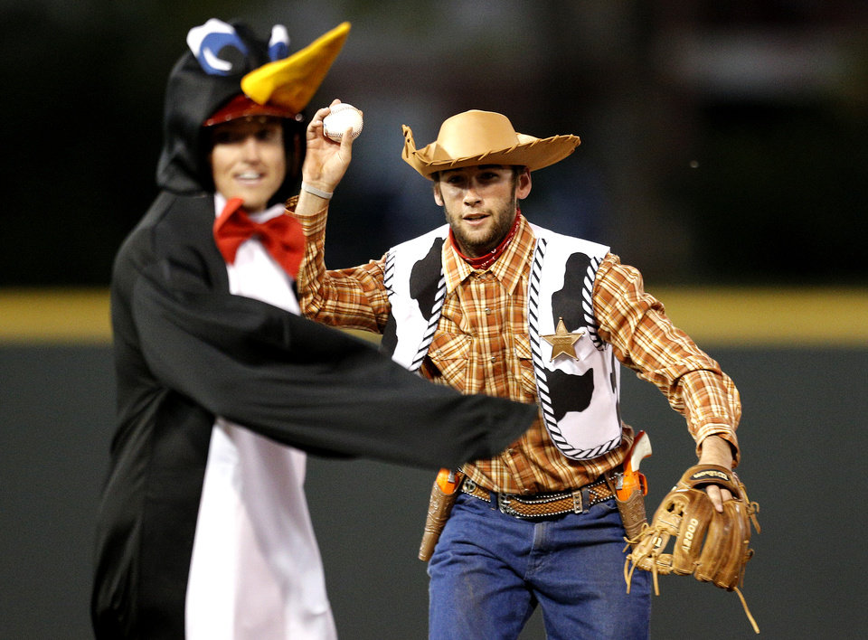 Penguin, Craig Aikin is caught in a run down as Woody, Keach Ballard, throws the ball to first during University of Oklahoma's baseball's  ALS Awareness Halloween Game at L. Dale Mitchell Park in Norman, Okla. , Thursday, Oct. 24, 2013. Photo by Sarah Phipps, The Oklahoman