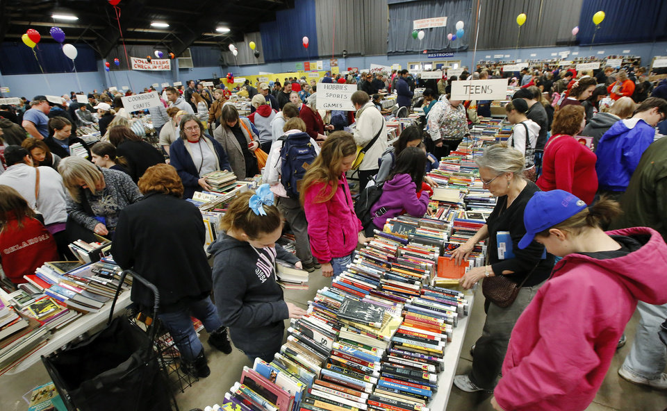Several thousand bibliophiles and bargain hunters crowded into Oklahoma Expo Hall at State Fair Park on Saturday, Feb. 23, 2013, in a quest to find reading material at deeply discounted prices. Friends of the Metropolitan Library System is holding their much-anticipated annual book sale this weekend. The sale continues Sunday from 9 a.m. to 5:30 p.m. Photo by Jim Beckel, The Oklahoman