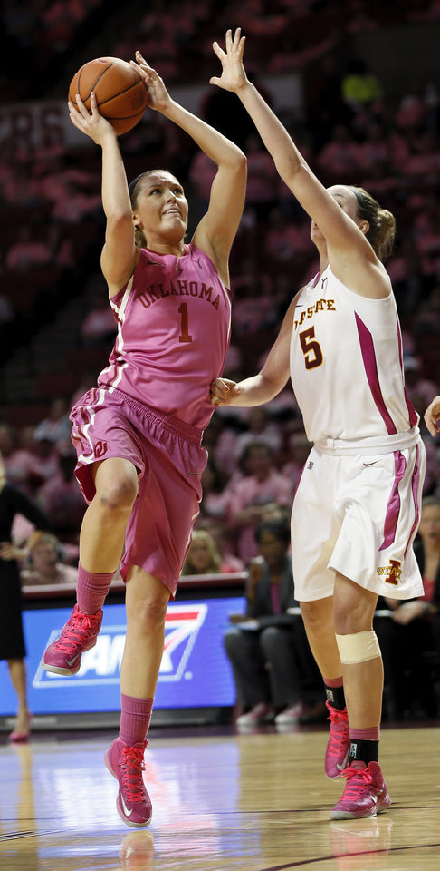 Photo - Oklahoma's Nicole Kornet (1) shoots against Iowa State's Hallie Christofferson (5) during an NCAA women's basketball game between the University of Oklahoma (OU) and Iowa State at the Lloyd Noble Center in Norman, Okla., Thursday, Feb. 14, 2013. Iowa State won, 72-68. Photo by Nate Billings, The Oklahoman
