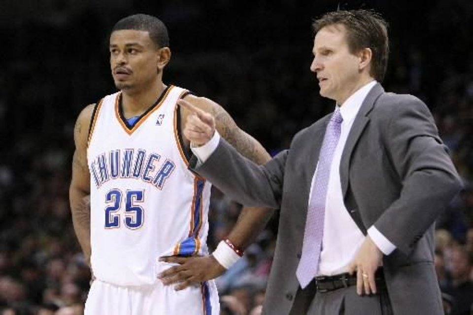 Oklahoma City guard Earl Watson and head coach Scott Brooks discuss strategy during the  Thunder - Miami game January 18, 2009 in Oklahoma City. BY HUGH SCOTT