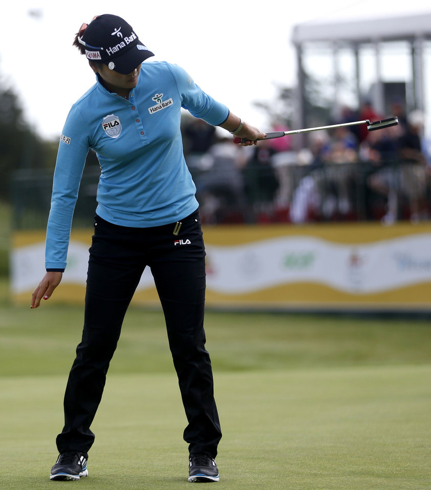 Photo - So Yeon Ryu, of South Korea, reacts after missing a putt on the 18th hole during the first round of the ShopRite LPGA Classic golf tournament in Galloway Township, N.J., Friday, May 30, 2014. (AP Photo/Julio Cortez)