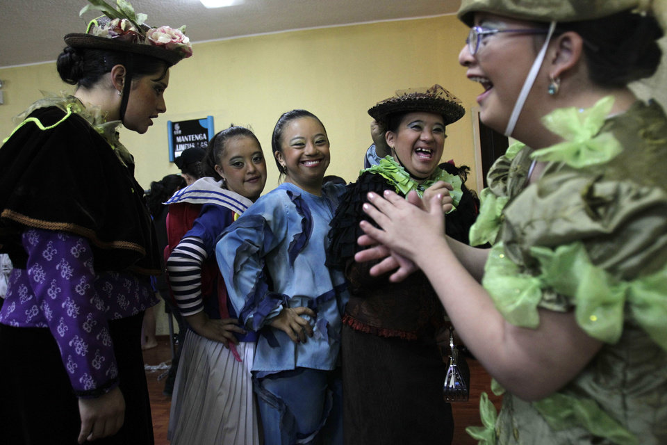 "In this Sept. 21, 2012 photo, cast members pose for a photo backstage prior to their performance in ""Suenos,"" or ""Dreams,"" one of Ecuador's most successful musicals, at the Casa de la Cultura theater in Quito, Ecuador. The musical is based in part on the dreams of young people with disabilities and is presented by the nonprofit foundation El Triangulo. (AP Photo/Dolores Ochoa)"