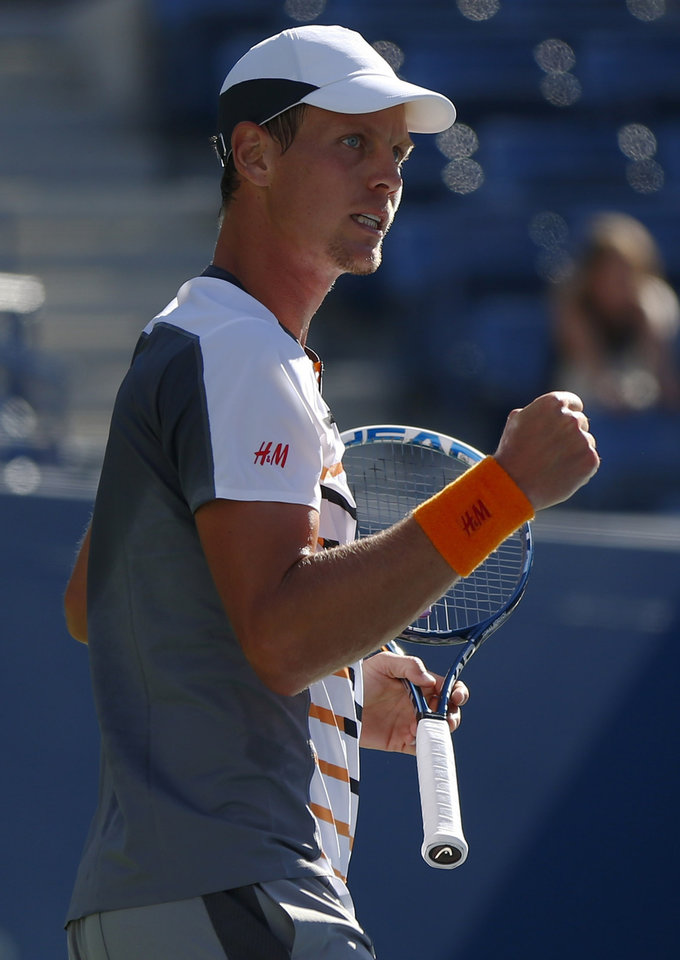 Photo - Tomas Berdych, of the Czech Republic, reacts after a point against Martin Klizan, of Slovakia, during the second round of the 2014 U.S. Open tennis tournament, Friday, Aug. 29, 2014, in New York. (AP Photo/Matt Rourke)