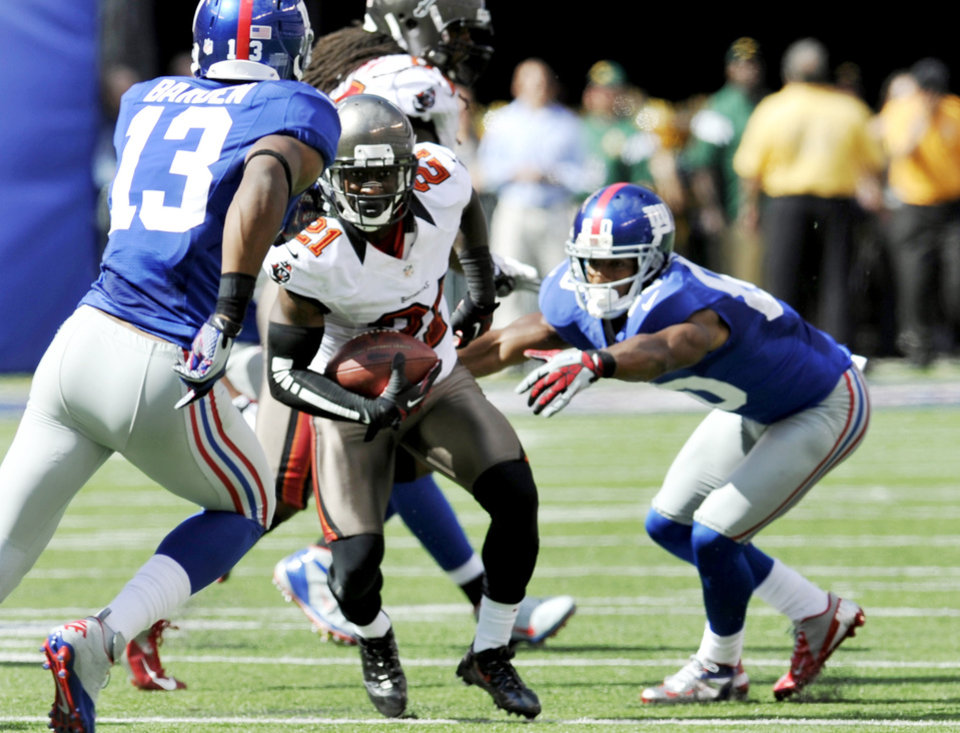 Photo -   Tampa Bay Buccaneers defensive back Eric Wright (21) breaks away from New York Giants wide receiver Victor Cruz (80) after intercepting a pass and running it back for a touchdown during the first half of an NFL football game, Sunday, Sept. 16, 2012, in East Rutherford, N.J. (AP Photo/Bill Kostroun)
