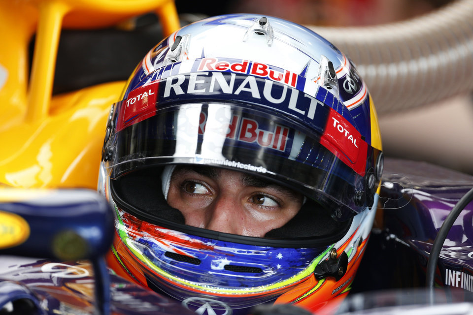 Photo - Australia's Daniel Ricciardo of Red Bull sits in his car at the pits during a practice session in Silverstone, England, on Friday, July 4, 2014, ahead of this weekend's Formula One British Grand Prix.The British Formula One Grand Prix will be held on Sunday July 6, 2014. (AP Photo/Lefteris Pitarakis)