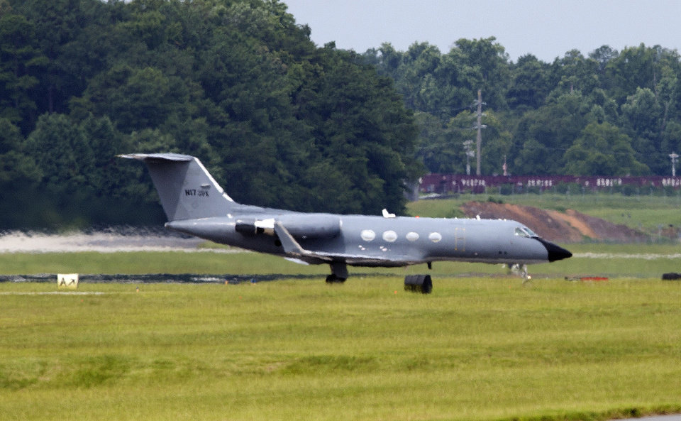 Photo - A plane taxies after arriving at Dobbins Air Reserve Base in Marietta., Ga., Saturday, Aug. 2, 2014. Officials at Emory University Hospital in Atlanta expect an American who is infected with the Ebola virus to be transported for treatment today. (AP Photo/John Bazemore)