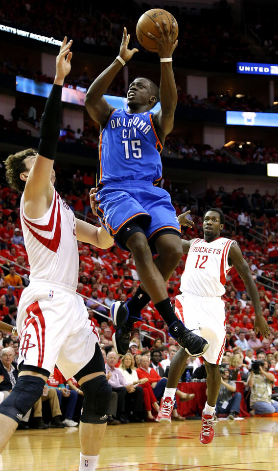 Oklahoma City\'s Reggie Jackson goes to the basket beside Houston\'s Omer Asik during Game 4 in the first round of the NBA playoffs between the Oklahoma City Thunder and the Houston Rockets at the Toyota Center in Houston, Texas, Monday, April 29, 2013. Photo by Bryan Terry, The Oklahoman