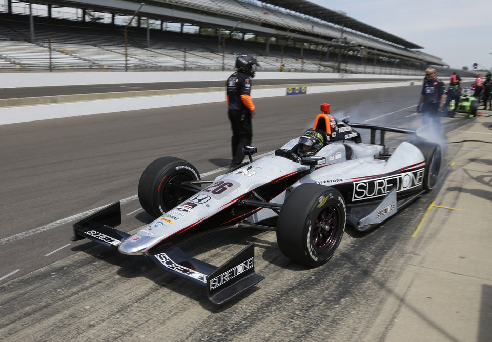 Photo - Kurt Busch drives out of the pit area during practice for the Indianapolis 500 IndyCar auto race at the Indianapolis Motor Speedway in Indianapolis, Monday, May 19, 2014. (AP Photo/Michael Conroy)