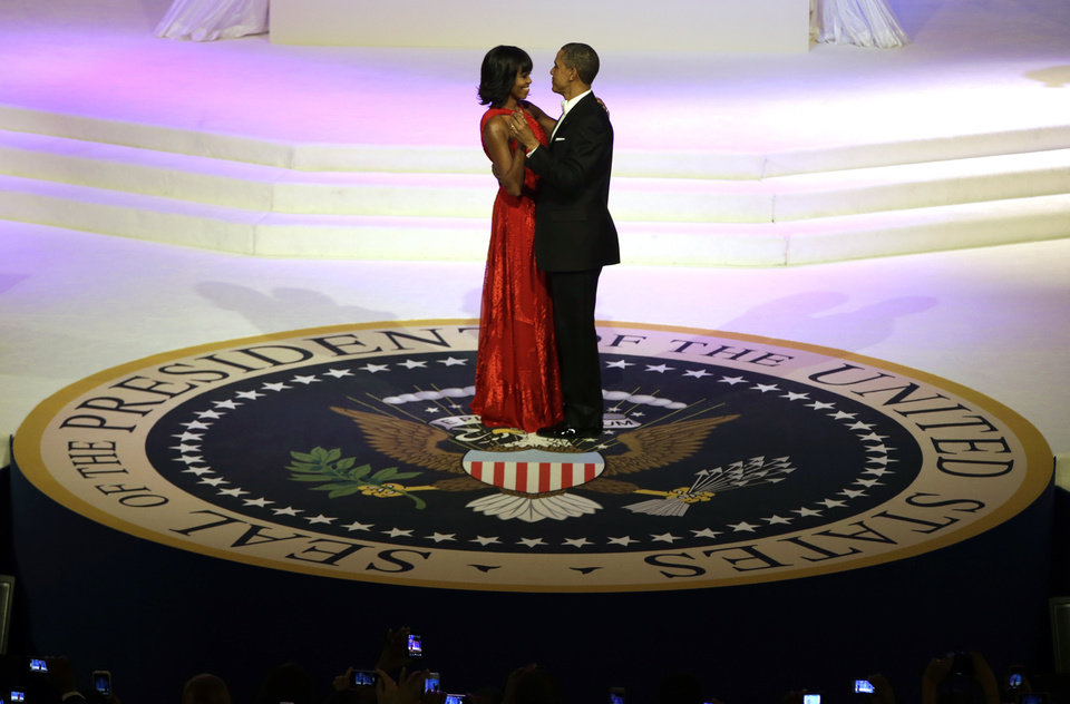 Photo - President Barack Obama and first lady Michelle Obama share a dance during the Commander-In-Chief Inaugural ball at the Washington Convention Center during the 57th Presidential Inauguration Monday, Jan. 21, 2013, in Washington.  (AP Photo/ Evan Vucci)