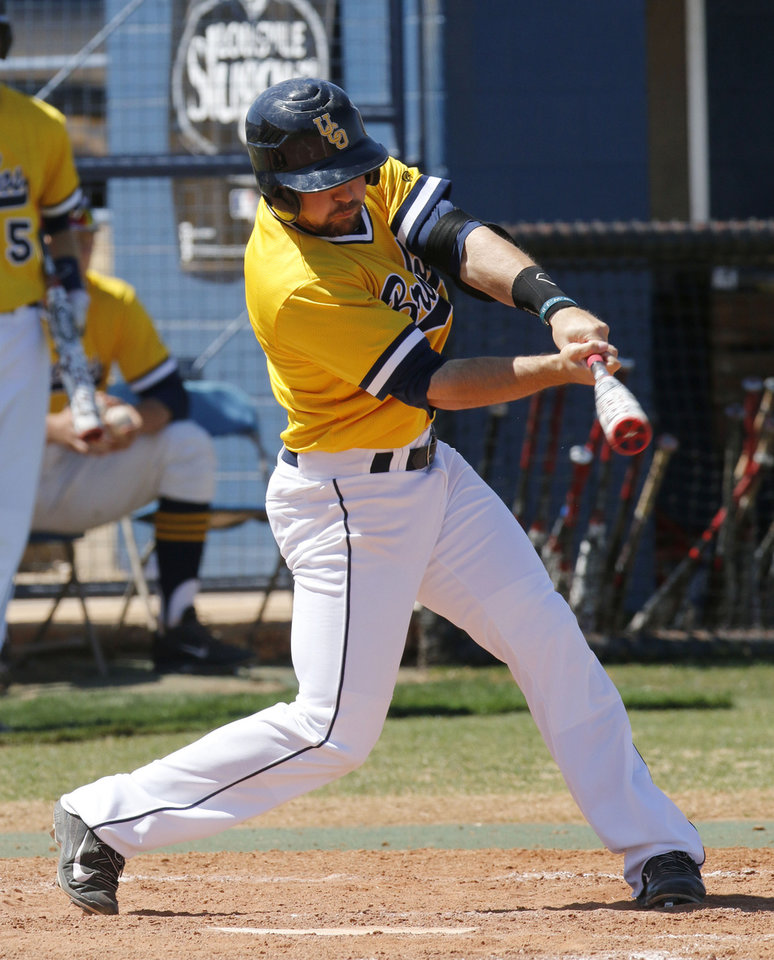 Photo - UCO senior Tyler Crabtree takes his turn at bat during a game at the University of Central Oklahoma in Edmond, OK, Friday, April 4, 2014. He was hit by pitches an NCAA Division II record 41 times last season.  Photo by Paul Hellstern, The Oklahoman