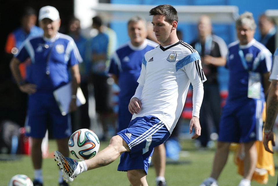 Photo - Argentina's Lionel Messi controls the ball during a training session at Itaquerao Stadium in Sao Paulo, Brazil, Monday, June 30, 2014. On Tuesday, Argentina will face Switzerland in their next World Cup soccer match.  (AP Photo/Victor R. Caivano)