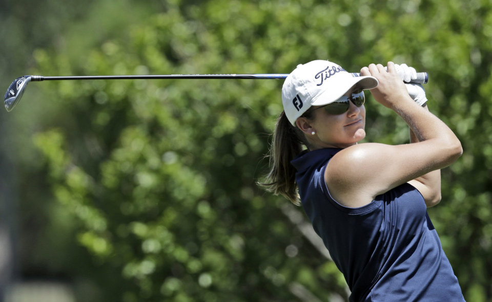 Photo - Dori Carter watches her tee shot on the second hole during the third round of the North Texas LPGA Shootout golf tournament at the Las Colinas Country Club in Irving, Texas, Saturday, May 3, 2014. (AP Photo/LM Otero)