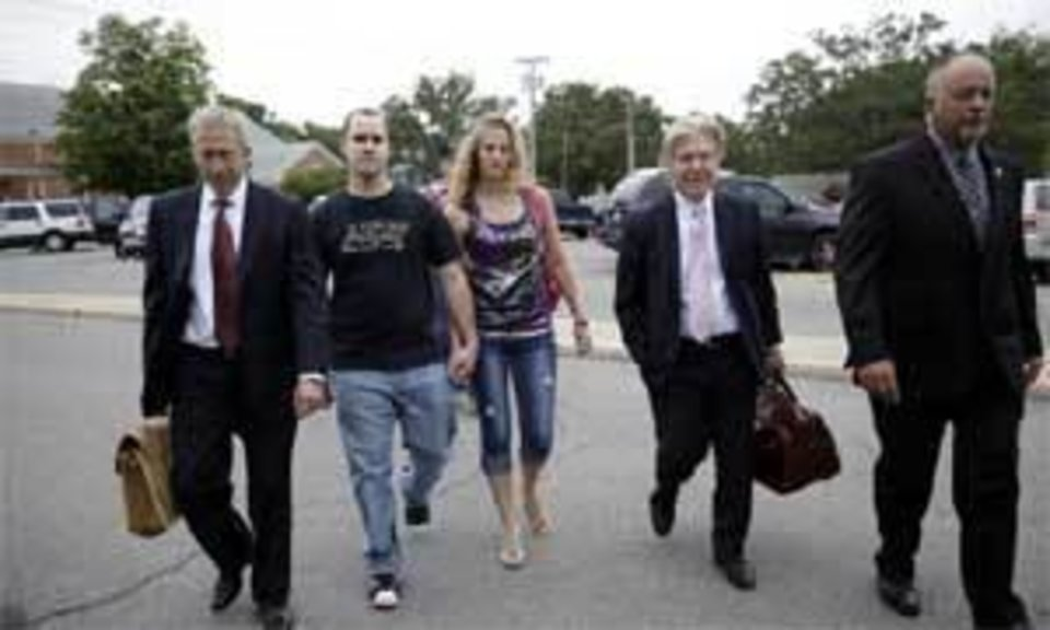 Photo - Baby Veronica's biological father, Dusten Brown (left) enters Cherokee County District Court on Friday morning with his wife, Robin Brown(right). MIKE SIMONS/Tulsa World