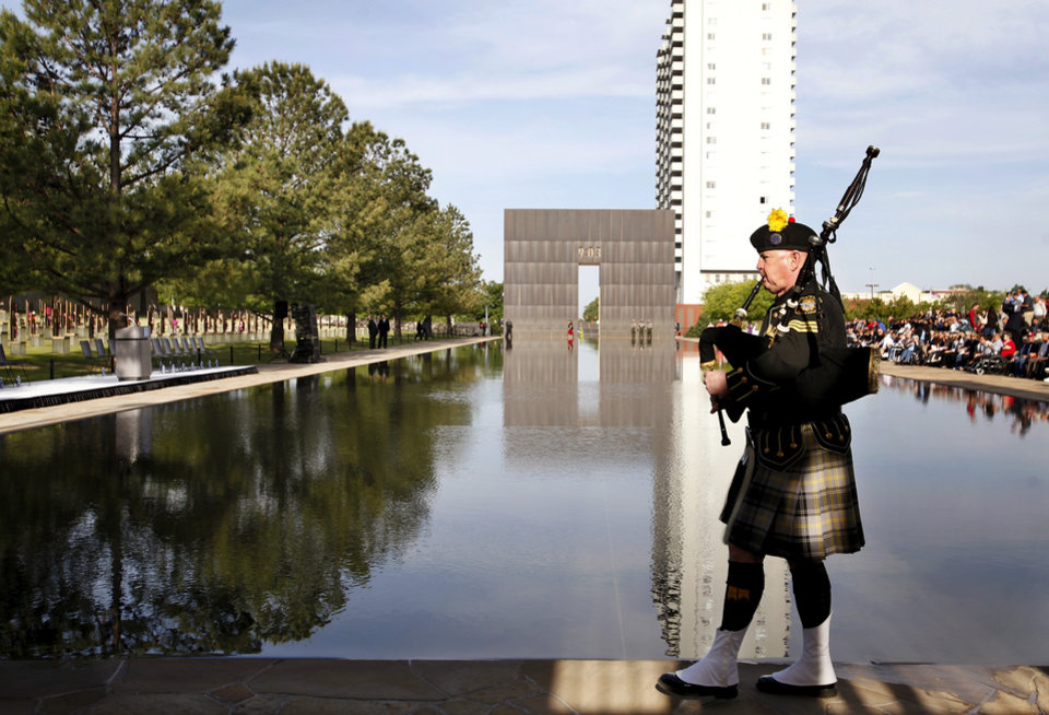 Kevin M. Donnelly, pipe sergeant, DEA Black and Gold Pipes and Drums, leads the procession of platform dignitaries as the program begins. An estimated crowd of 2,000  attended the  Remembrance Ceremony to mark  the 17th anniversary of the 1995 bombing of the Alfred P. Murrah Federal Building in downtown Oklahoma City in which 168 people were killed.  Photo taken April 19, 2012.        Photo by Jim Beckel, The Oklahoman