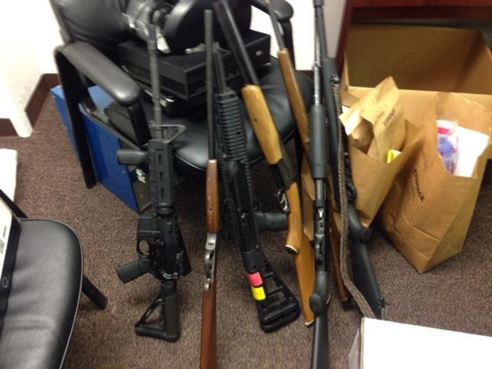 Photo -  Weapons were seized from a residence in Yukon on Tuesday. [Photo provided by Canadian County Sheriff's Department.]