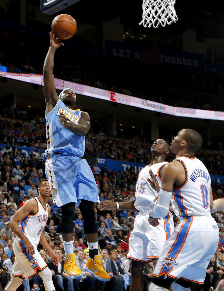 Oklahoma City\'s Perry Jones (3) puts up as Oklahoma City\'s Thabo Sefolosha (2), Reggie Jackson (15), and Russell Westbrook (0) watch during an NBA basketball game between the Oklahoma City Thunder and the Denver Nuggets at Chesapeake Energy Arena in Oklahoma City, Tuesday, March 19, 2013. Denver won 114-104. Photo by Bryan Terry, The Oklahoman