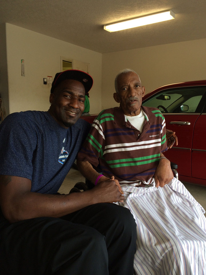 Kendrick Perkins and his grandfather Raymond Lewis, who passed away Nov. 11. PHOTO PROVIDED <strong></strong>