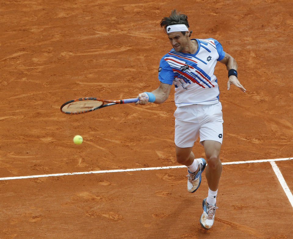 Photo - David Ferrer of Spain, returns the ball to Rafael Nadal of Spain during their quarterfinals match of the Monte Carlo Tennis Masters tournament in Monaco, Friday, April 18, 2014. Ferrer won 7-6 6-4. (AP Photo/Michel Euler)
