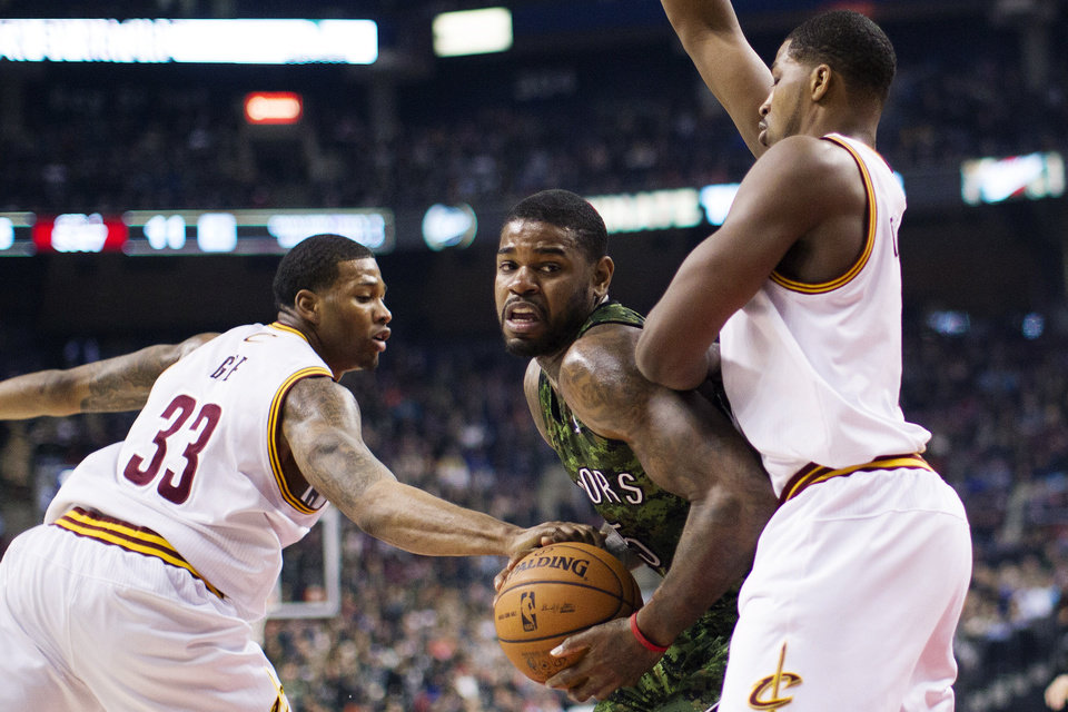 Toronto Raptors' Amir Johnson, center, drives between Cleveland Cavaliers' Alonzo Gee (33) and Tristan Thompson during the first half of an NBA basketball game, Saturday, Jan. 26, 2013, in Toronto. (AP Photo/The Canadian Press, Chris Young)