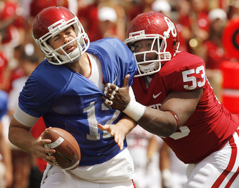 Photo - Defensive tackle Casey Walker sacks quarterback Landry Jones in the first period during the University of Oklahoma Sooner's (OU) Spring Football game at Gaylord Family-Oklahoma Memorial Stadium on Saturday, April 16, 2011, in Norman, Okla.  