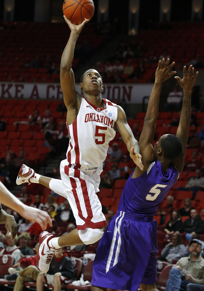 Oklahoma's Je'lon Hornbeak (5) puts off a shot over Stephen F. Austin's Antonio Bostic (5) during a college basketball game between the University of Oklahoma (OU) and Stephen F. Austin University at the Lloyd Noble Center in Norman, Okla., Tuesday, Dec. 18, 2012. Photo by Bryan Terry, The Oklahoman