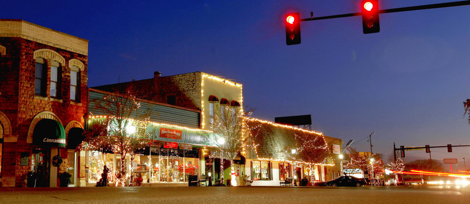 Christmas lights adorn historic buildings in downtown Edmond. PHOTO BY BRYAN TERRY, OKLAHOMAN ARCHIVE