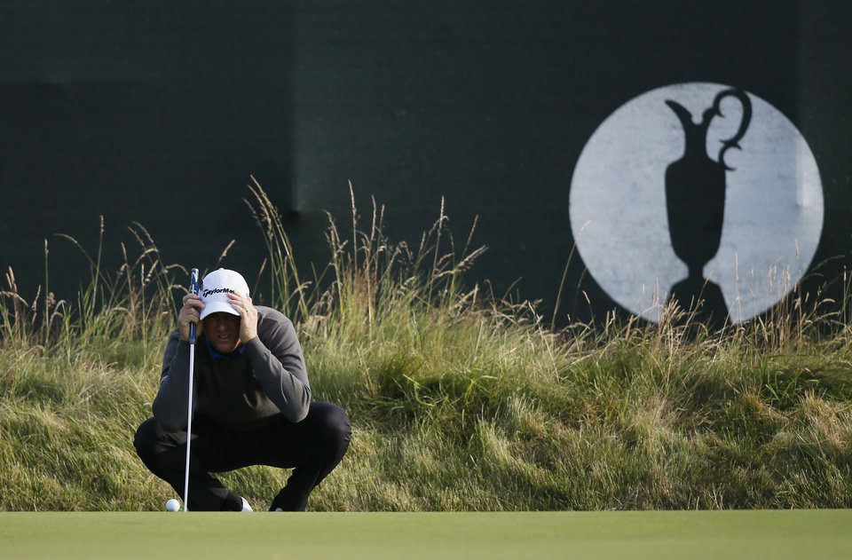 Photo - Robert Karlsson of Sweden lines up a putt on the 3rd green during the first day of the British Open Golf championship at the Royal Liverpool golf club, Hoylake, England, Thursday July 17, 2014. (AP Photo/Alastair Grant)