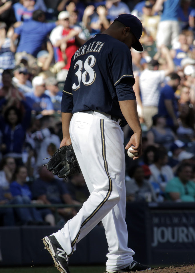 Photo - Milwaukee Brewers pitcher Wily Peralta reacts after giving up a two-run home run to Chicago Cubs' Anthony Rizzo, during the sixth inning of a baseball game Saturday, May 31, 2014, in Milwaukee. (AP Photo/Darren Hauck)