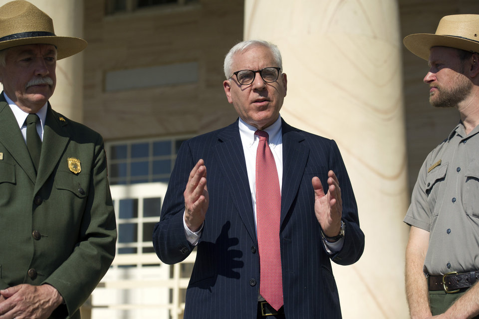 Photo - Philanthropist David Rubenstein center, speaks as he joined by Park Ranger and project manager, Brandon Bies, right, and National Park Service Director Jonathan Jarvis, left,  during a news conference at historic Arlington House at Arlington National Cemetery in Arlington, Va., Thursday, July 17, 2014.  The historic house and plantation originally built as a monument to George Washington overlooking the nation's capital that later was home to Confederate Gen. Robert E. Lee and 63 slaves will be restored to its historical appearance after a $12.3 million gift from Rubenstein.  (AP Photo/Cliff Owen)