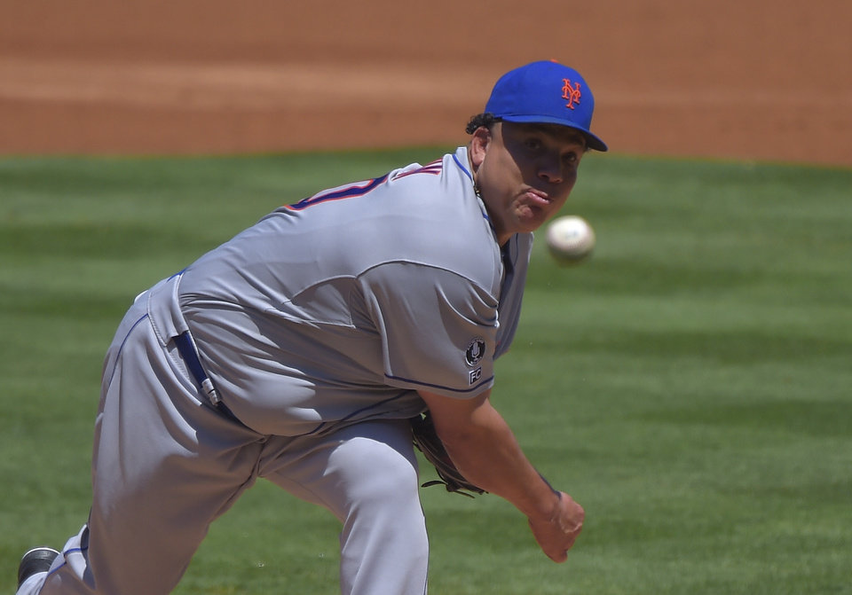 Photo - New York Mets starting pitcher Bartolo Colon throws to the plate during the first inning of a baseball game against the Los Angeles Dodgers, Sunday, Aug. 24, 2014, in Los Angeles. (AP Photo/Mark J. Terrill)