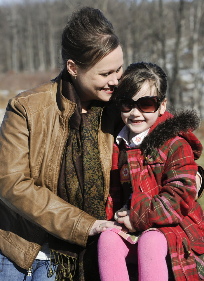 In this Feb. 10, 2013 photo, Kelly Guarna and her 5-year-old daughter Madison pose for a portrait in Mount Carmel, Pa. The kindergartener was suspended from school for making a