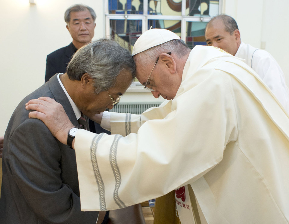 Photo - In this photo provided by the L' Osservatore Romano, Pope Francis baptizes Lee Ho Jin, the father of one of the children who died in South Korea's April ferry disaster, in Seoul, South Korea, Sunday, Aug. 17, 2014. (AP Photo/L' Osservatore Romano)