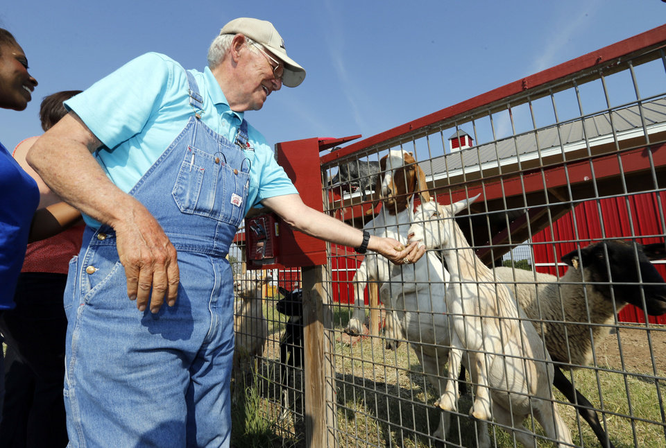 Dr. Glenn Orr feed goats as he gives a tour of new and repaired buildings at Orr Family Farms on Thursday, Sept. 12, 2013 in Oklahoma City, Okla.  Photo by Steve Sisney, The Oklahoman