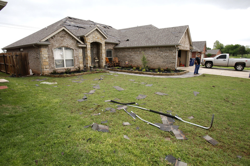 This home at 543 W. Geronimo Courtway in Mustang was damaged by a small tornado which touched down early Saturday. <strong>PAUL HELLSTERN - Oklahoman</strong>