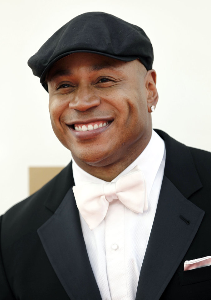 Photo -   FILE - In this Sept. 18, 2011 file photo, LL Cool J arrives at the 63rd Primetime Emmy Awards in Los Angeles. Los Angeles police say the rapper grabbed and held a burglary suspect at his Studio City home Wednesday morning Aug. 22,2012. (AP Photo/Matt Sayles, File)