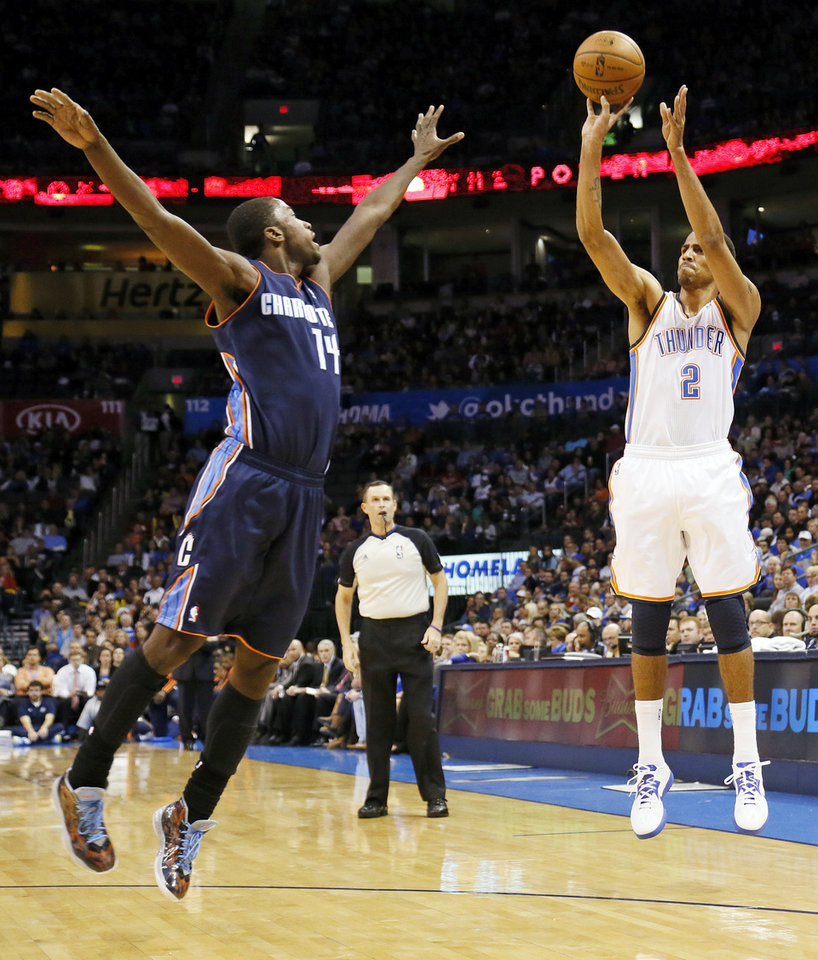Oklahoma City's Thabo Sefolosha (2) shoots over Charlotte's Michael Kidd-Gilchrist (14) during an NBA basketball game between the Oklahoma City Thunder and Charlotte Bobcats at Chesapeake Energy Arena in Oklahoma City, Monday, Nov. 26, 2012.  Photo by Nate Billings , The Oklahoman