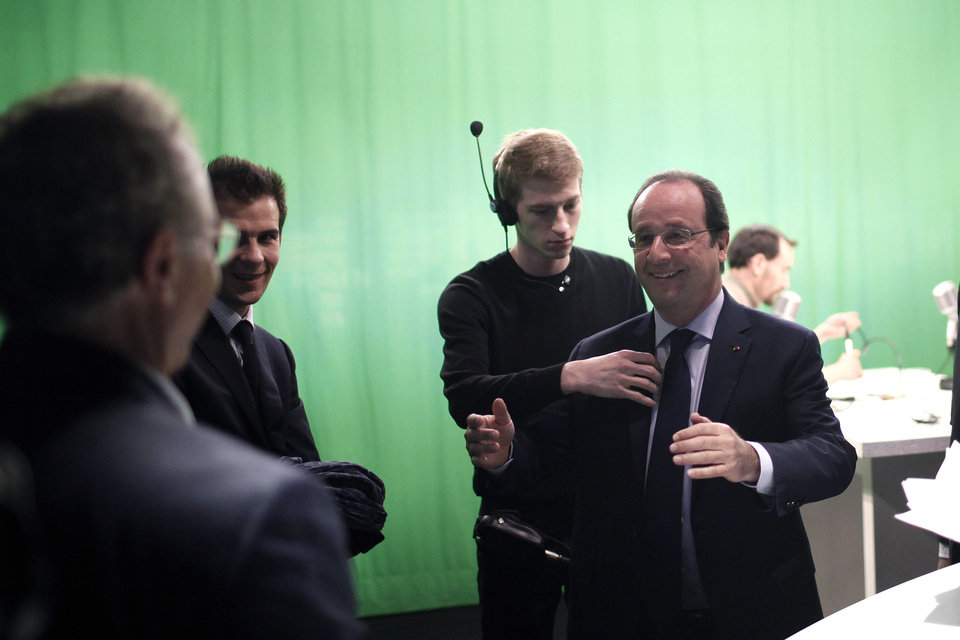 Photo - France's President Francois Hollande, right, smiles after an interview with BFM television journalist in Paris, Tuesday, May 6, 2014. Hollande celebrates Tuesday his second anniversary in charge. (AP Photo/Thibault Camus, Pool)