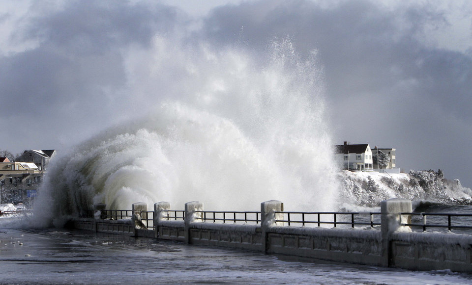 Photo - Heavy surf breaks over the seawall after a winter storm, Friday, Jan. 3, 2014, in Hampton, N.H. (AP Photo/Jim Cole)