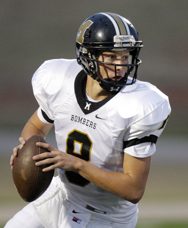 Joel Davis (8) of Midwest City looks to pass during a high school football game between Midwest City and Edmond Santa Fe at Wantland Stadium in Edmond, Okla., Thursday, Sept. 15, 2011. Photo by Nate Billings, The Oklahoman