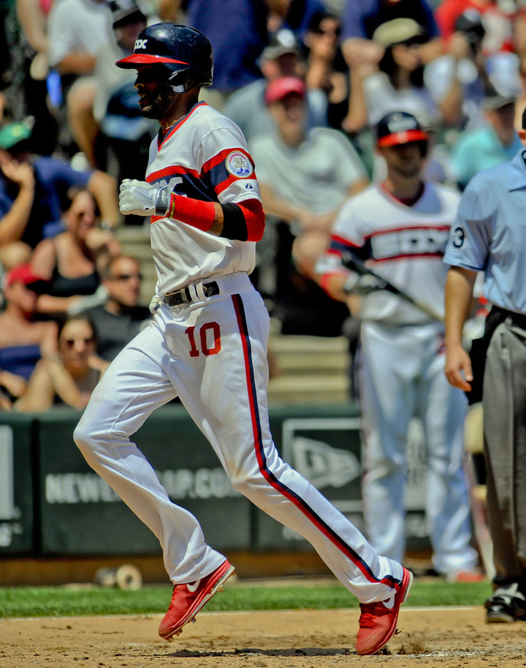 Photo - Chicago White Sox' Alexei Ramirez scores off of the Chicago White Sox' Alejandro De Aza ground ball during the second inning of a baseball game against the San Diego Padres on Saturday, May 31, 2014, in Chicago. (AP Photo/Matt Marton)