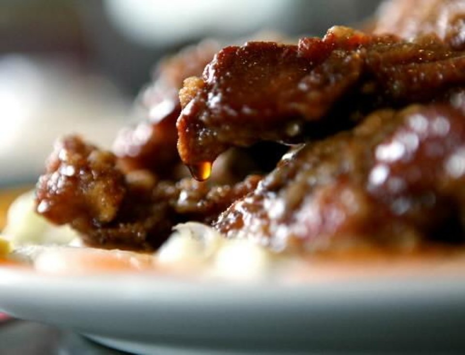 Sauce drips from Peking Spare Ribs at Chow's Chinese Restaurant in Oklahoma City. Photo by John Clanton