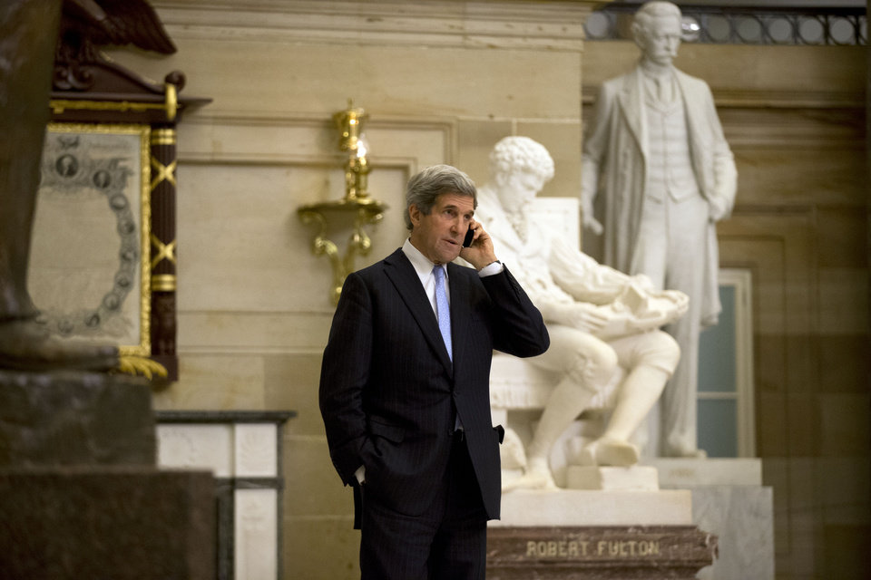 Photo - Sen. John Kerry, D-Mass., talks on a phone in Statuary Hall on Capitol Hill, Thursday, Dec. 20, 2012 in Washington.  President Obama will nominate Sen. John Kerry as his next secretary of state, a senior administration official says, making the first move in a sweeping overhaul of his national security team heading into a second term.   (AP Photo/Alex Brandon)