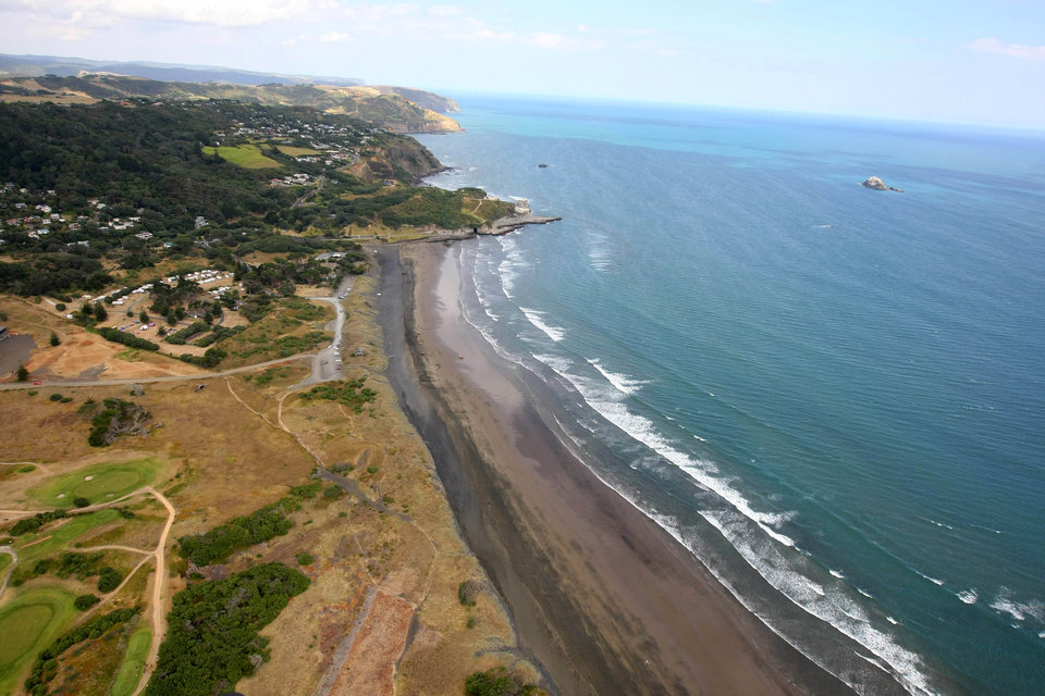 Photo - Muriwai Beach near Auckland, New Zealand, is seen from the air Wednesday, Feb. 27, 2013, following a fatal shark attack.  Police said a man was found dead in the water Wednesday afternoon after being