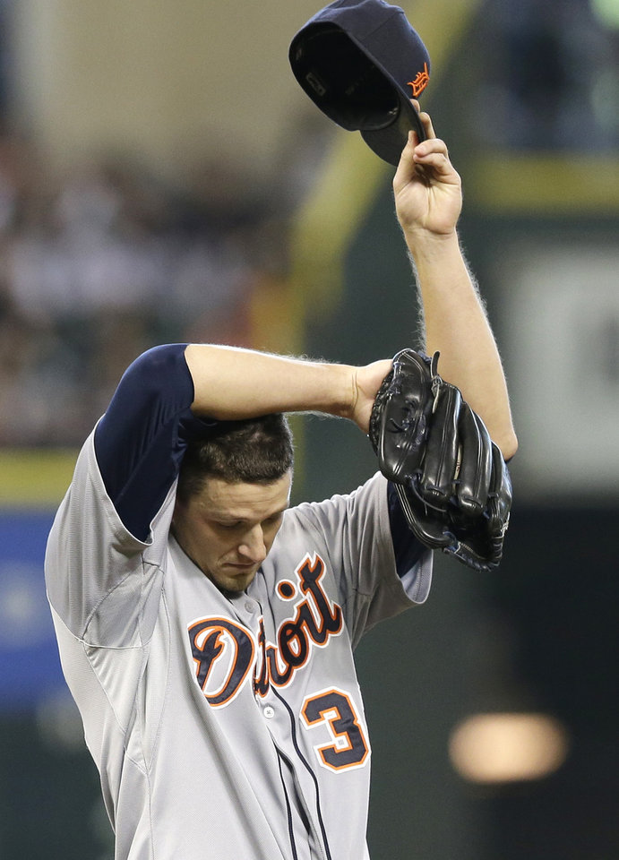 Photo - Detroit Tigers starting pitcher Drew Smyly wipes his head after giving up an RBI single to Houston Astros' Jesus Guzman in the first inning of a baseball game Sunday, June 29, 2014, in Houston. (AP Photo/Pat Sullivan)