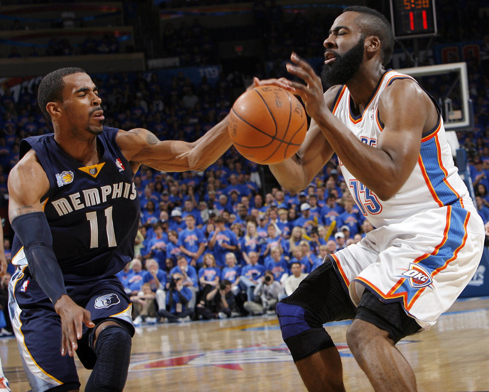 Mike Conley (11) of Memphis knocks the ball away from James Harden (13) of Oklahoma City in the first half during game 7 of the NBA basketball Western Conference semifinals between the Memphis Grizzlies and the Oklahoma City Thunder at the OKC Arena in Oklahoma City, Sunday, May 15, 2011. Photo by Nate Billings, The Oklahoman