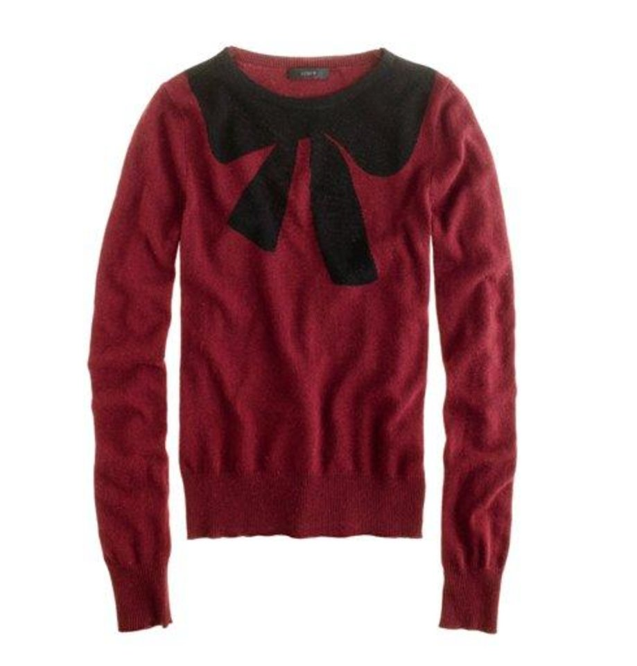 Photo - This undated publicity photo provided by J.Crew shows a crewneck sweater decorated with an oversized bow motif at the neckline by J.Crew. The good, the bad, the kitschy. A